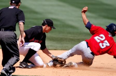 Tips for 3rd basemen, How to apply a tag to a sliding base runner. Free Instruction for third basemen on receiving throws from the catcher and from outfield